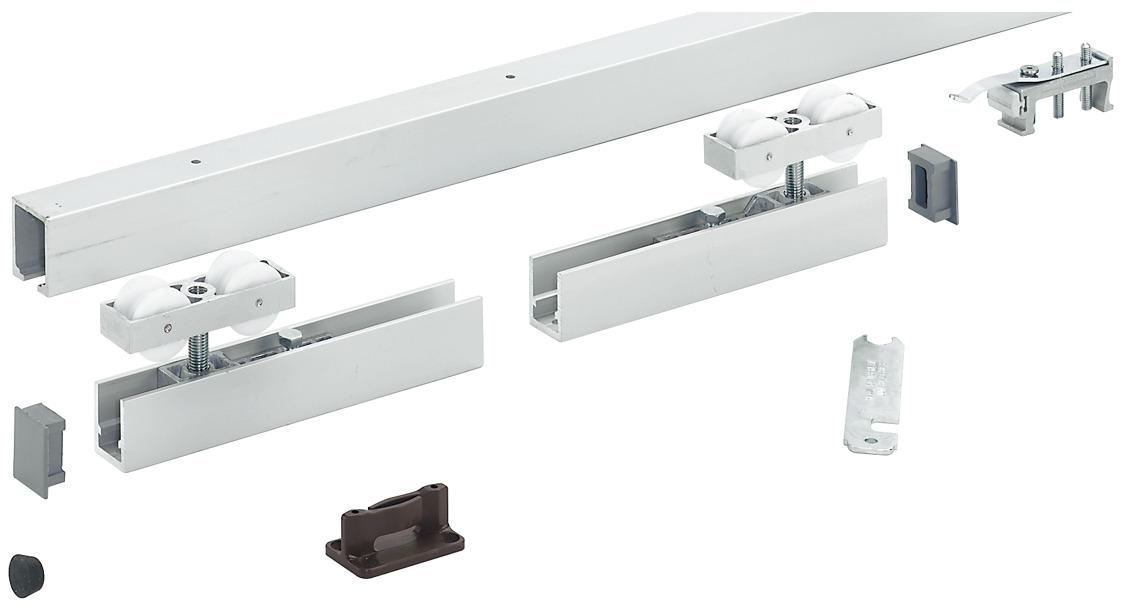 Sliding door system for interior doors with low headroom for Interior sliding door track system
